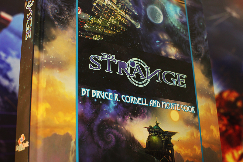 The Strange RPG book by Bruce R. Cordell and Monte Cook.